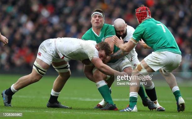 Stander of Ireland is held by Sam Underhill and Joe Marler during the 2020 Guinness Six Nations match between England and Ireland at Twickenham...