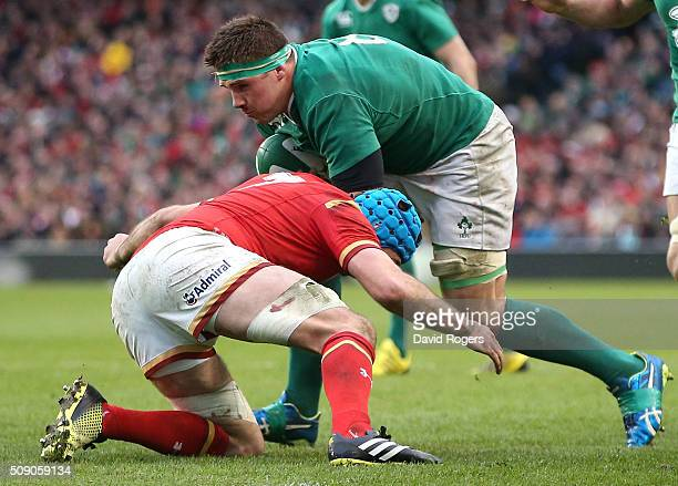 Stander of Ireland is tackled by Justin Tipuric during the RBS Six Nations match between Ireland and Wales at the Aviva Stadium on February 7 2016 in...