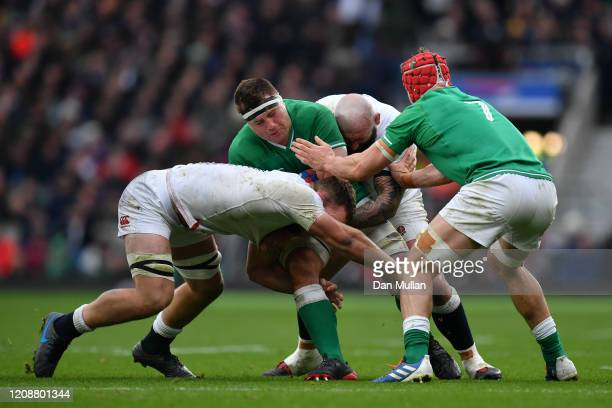 Stander of Ireland is tackled by Sam Underhill and Joe Marler of England during the 2020 Guinness Six Nations match between England and Ireland at...