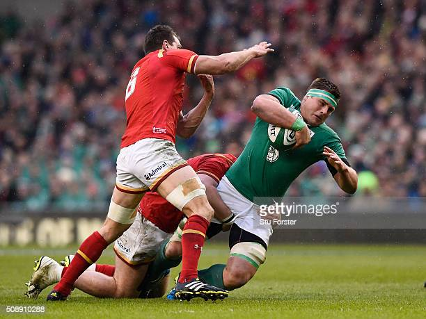 Stander of Ireland is tackled by Sam Warburton of Wales during the RBS Six Nations match between Ireland and Wales at the Aviva Stadium on February 7...