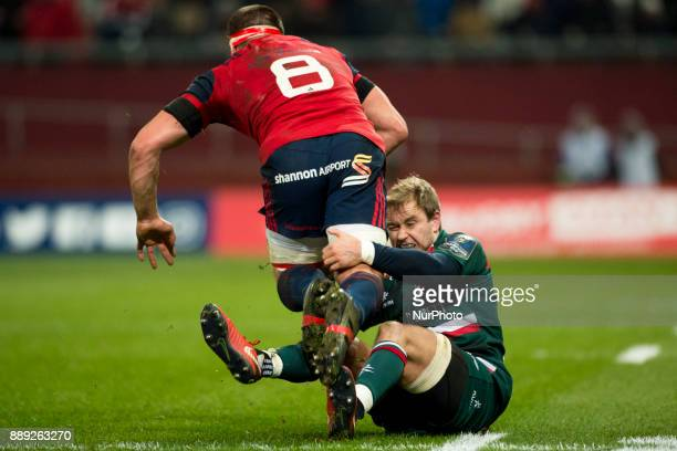 CJ Stander of Munster tackled by Matthew Tait of Leicester during the European Rugby Champions Cup Round 3 match between Munster Rugby and Leicester...