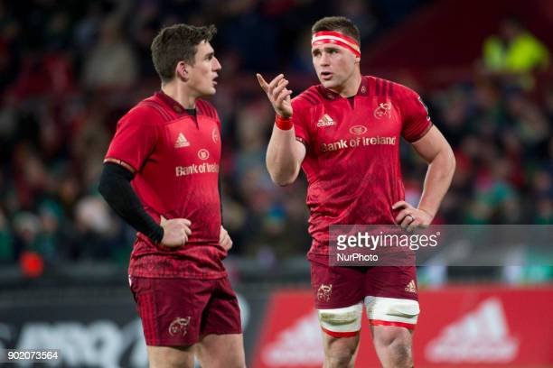CJ Stander of Munster talks with his teammate Ian Keatley during the Guinness PRO14 Round 13 rugby match between Munster Rugby and Connacht Rugby at...