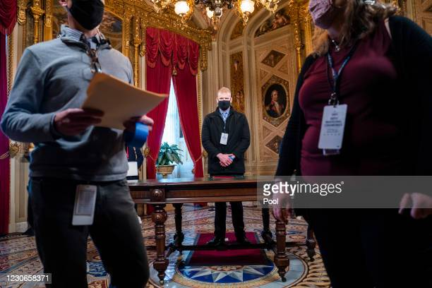 Stand-in portraying President-elect Joe Biden rehearses the upcoming inauguration in the Presidents Room of the US Capitol at the U.S. Capitol on...