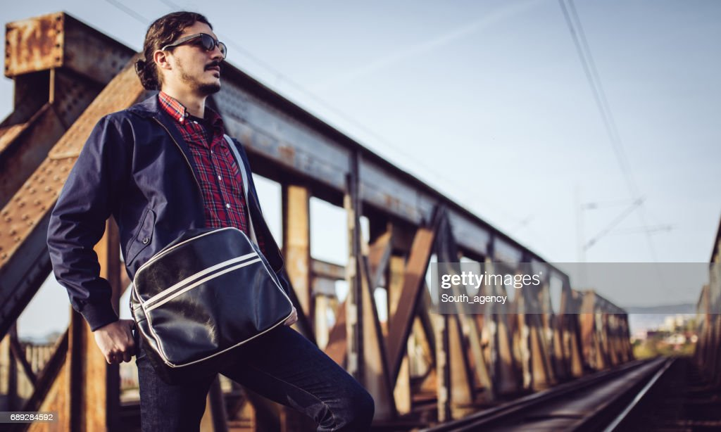 Standing alone on the bridge : Stock Photo