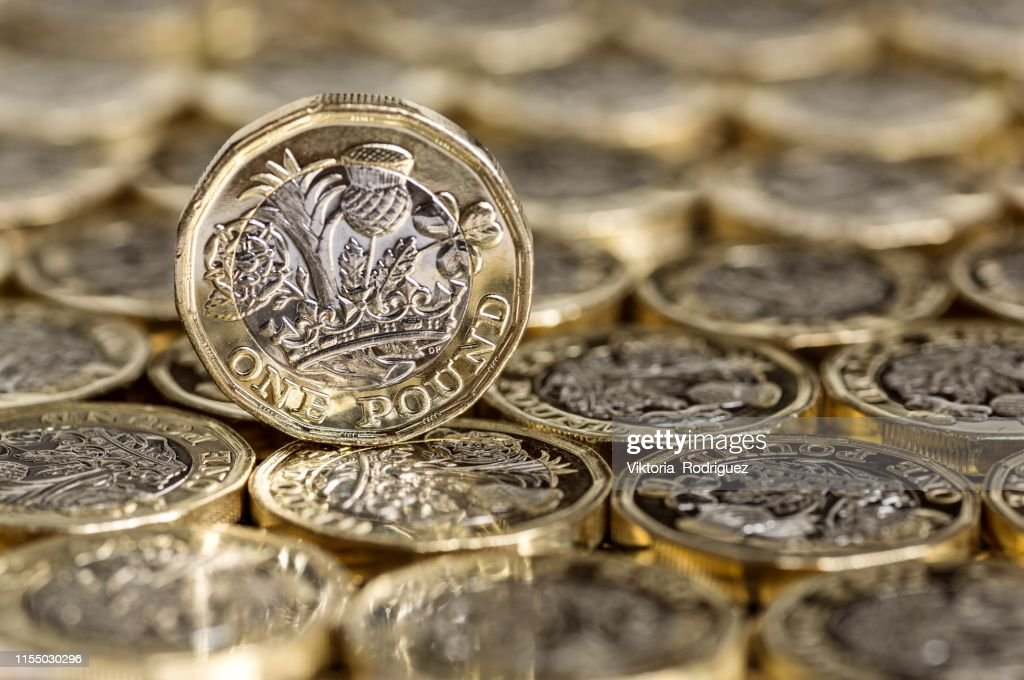 Standing alone one pound coin : Stock Photo