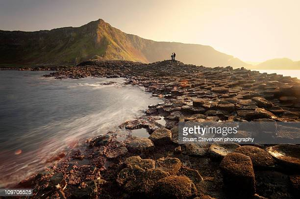 standing amongst giants - giant's causeway stock pictures, royalty-free photos & images