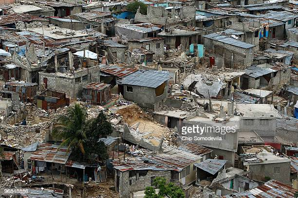 Standing and collapsed homes cover the hillside in the Le Vallee de Bourdon neighborhood February 18, 2010 in Port-au-Prince, Haiti. More than a...