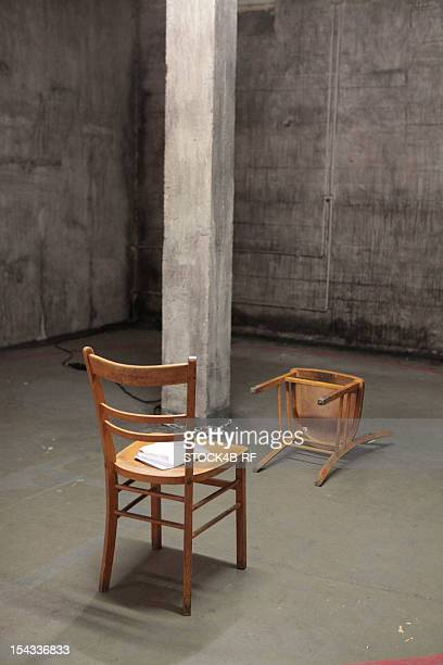 Standing and lying chair in a sparse room