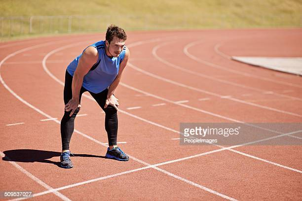 standing at the finishing line - forward athlete stock pictures, royalty-free photos & images