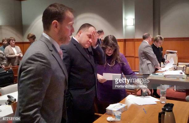 Standing between attorney Timothy Zerillo and attorney Amy Fairfield Anthony Sanborn is overcome with emotion while adressing Justice Joyce Wheeler...