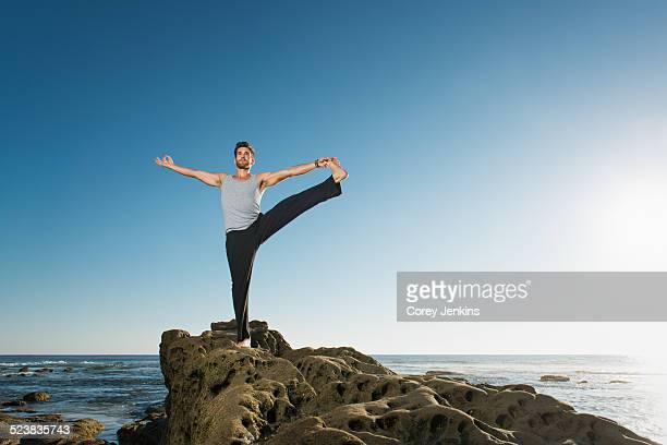 Standing Big Toe pose - Utthita Hasta Padangusthasana, Windansea beach, La Jolla, California