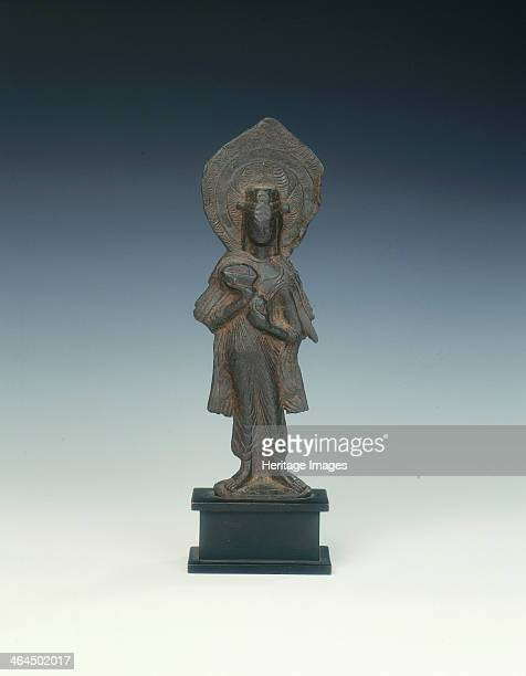 Standing bodhisattva Six Dynasties China early 6th century An iron bodhisattva with pointed cloud incised mandorla The garments and stance are in...