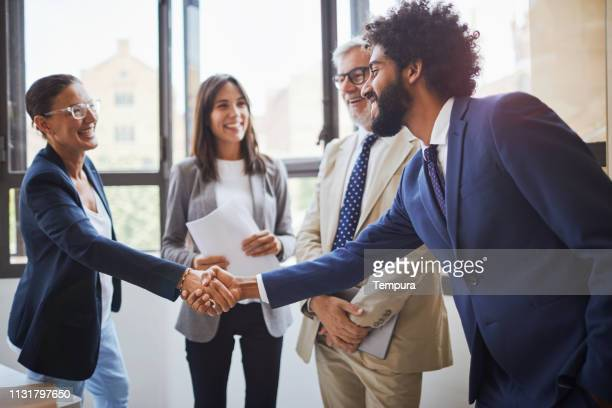 standing business meeting. - businesswear stock pictures, royalty-free photos & images