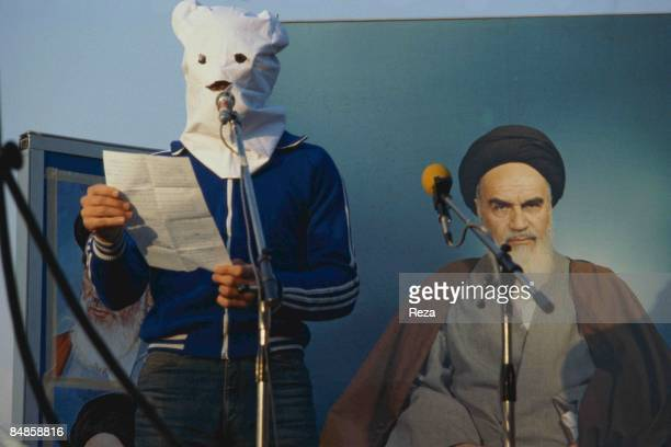 Standing by the poster of the religious leader of the 1979 Iranian revolution Ruhollah Musavi Khomein oppositionist Iraqi man use the US embassy...