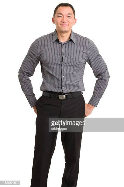 standing content asian man - trousers stock pictures, royalty-free photos & images