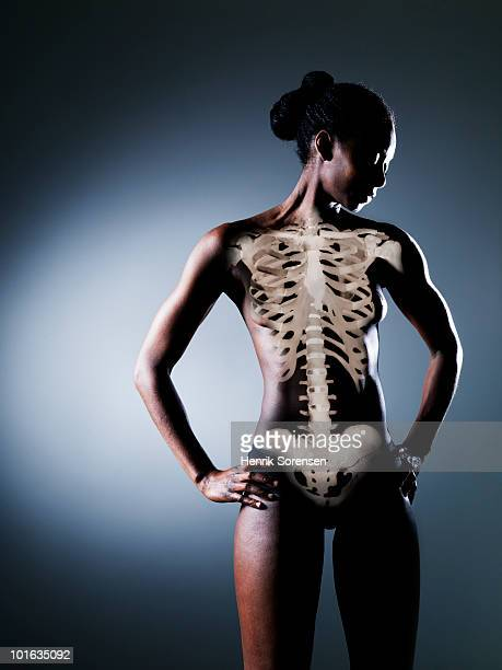 Standing female nude with skeleton visible