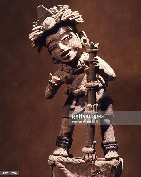 Standing figure holding a staff and cup During religious festivals large amounts of alcoholic drinks were consumed Mexico Veracruz AD 250 550...