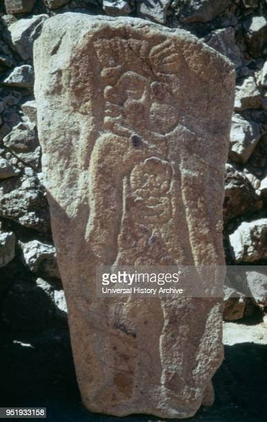 standing figure of one of the ñLos Danzantesî a collection of more than 300 basreliefs at Monte Alban Monte Alban is a large preColumbian...