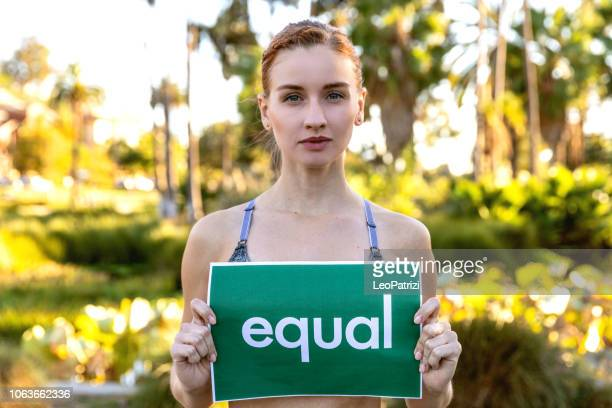 standing for equity rights in the world - wage gap stock pictures, royalty-free photos & images
