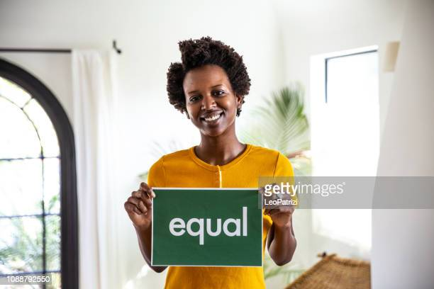 standing for equity rights in the world - black civil rights stock pictures, royalty-free photos & images