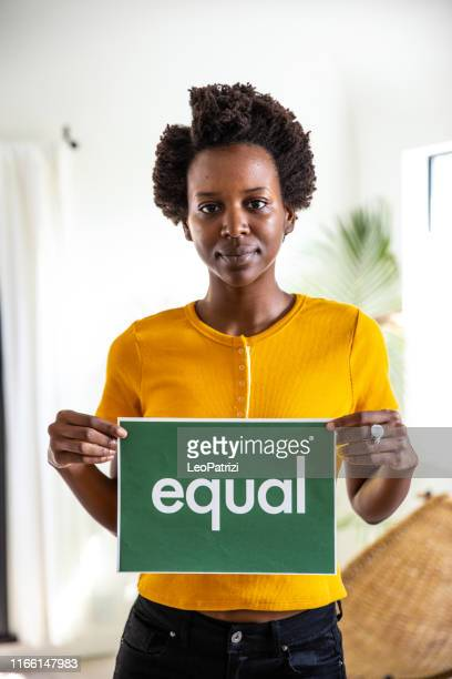 standing for equity rights in the world - anti racism stock pictures, royalty-free photos & images