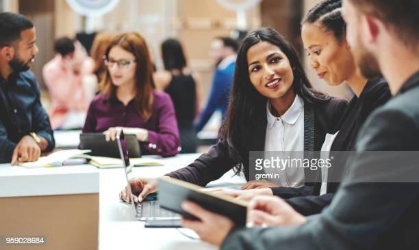 standing group of business people in the meeting - indian ethnicity stock pictures, royalty-free photos & images