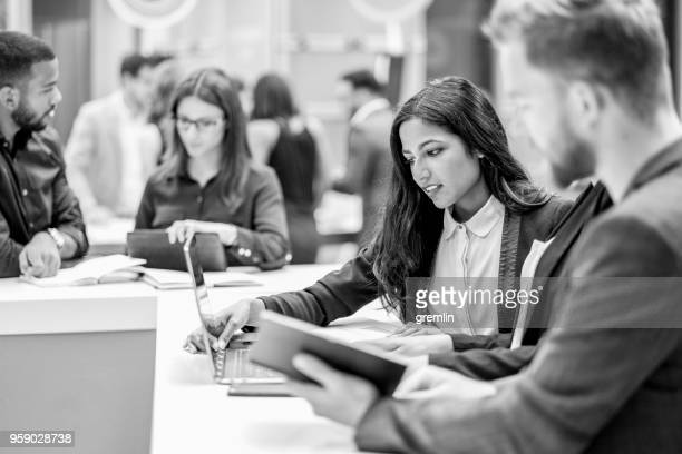 standing group of business people in the meeting - monochrome stock pictures, royalty-free photos & images