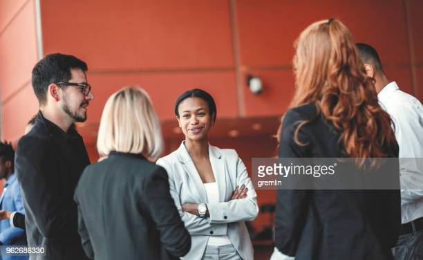 standing group of business people in the office, coffee break - lobby stock pictures, royalty-free photos & images