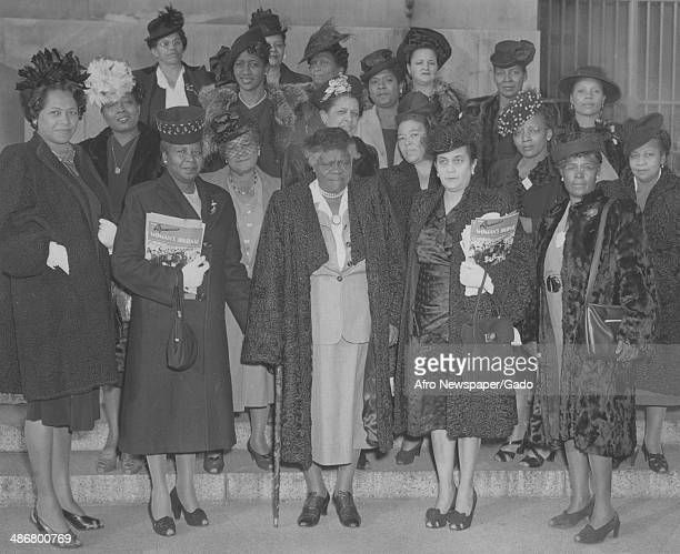 A standing group photo of delegates from North and South Carolina including civil rights leader Mary McLeod Bethune and Lillie Justice at a meeting...