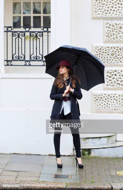 Standing in Belgravia Russian outdoor girl fashion model umbrella