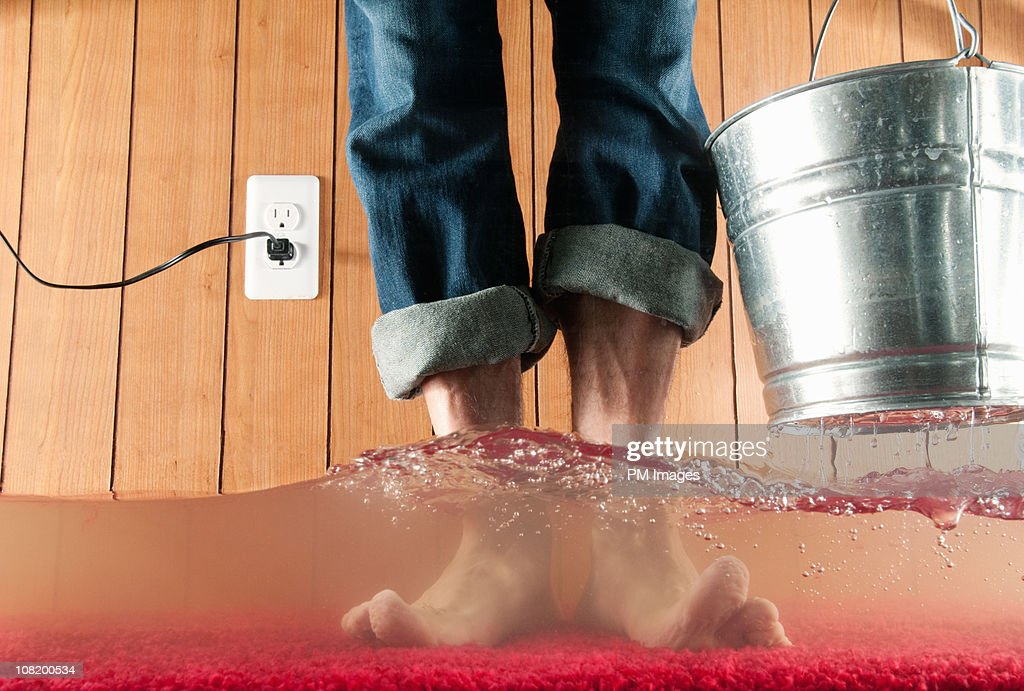 Standing In Flooded Basement : Foto stock