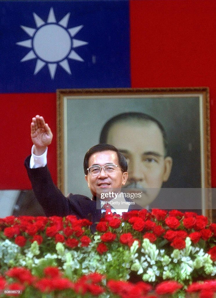 Standing in front of a portrait of Dr. Sun Yat-sen, founding father of the Republic of China, Taiwan President Chen Shui-bian salutes the audience before delivering a much awaited speech during the inauguration ceremony starting his second four-year term in the office of president, 20 May 2004, in front of the Presidential Building in Taipei. Chen has promised to clear up misunderstandings with rival China in the inauguration speech, after Beijing issued new threats to attack the island.