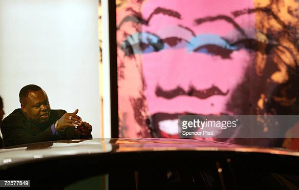 Standing in front of a print of the Warhol painting 'Orange Marilyn' a driver waits for his client who is inside the auction house Christie's during...