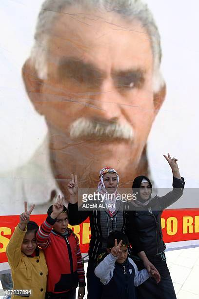 Standing in front of an image of jailed Kurdish rebel leader Abdullah Ocalan Kurds rally during Newroz celebrations marking the Kurdish New Year on...