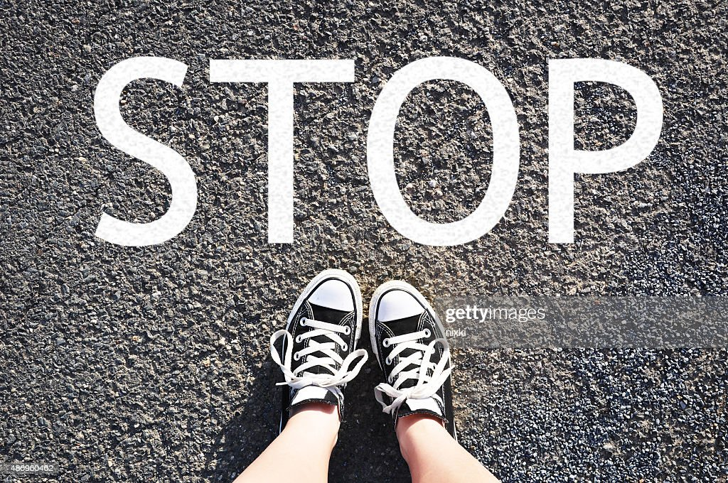 Standing in front of STOP sign : Stock Photo