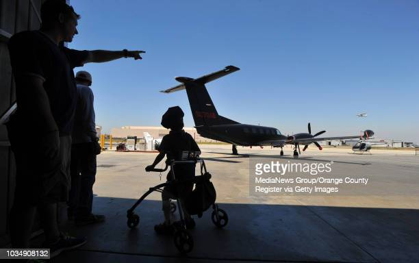 Standing in his walker Cael Studebaker looks over the tarmac before taking a flight in Long Beach CA on Thursday July 10 2014 This is the 13th year...