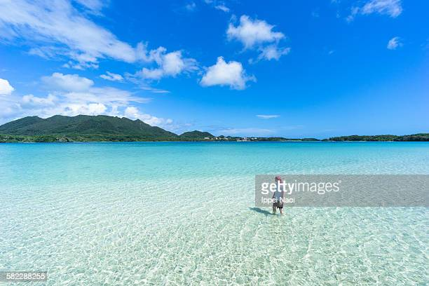Standing in shallow tropical beach water, Okinawa