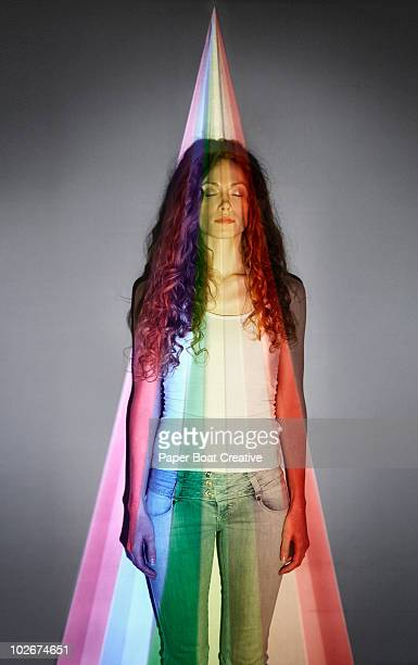 standing in the middle of a rainbow projection