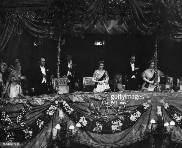 Standing in the royal box are left to right Crown Princess of Norway Crown Prince of Norway Viscount Waverley Queen Elizabeth II the Duke of...