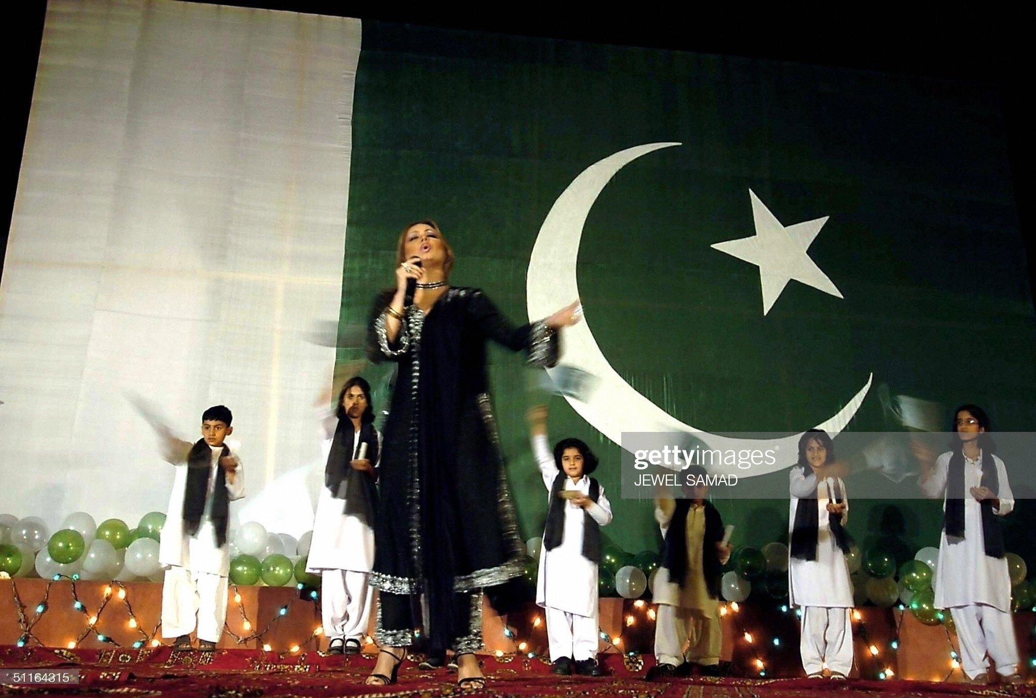 Standing infront of a huge Pakistani fla : News Photo