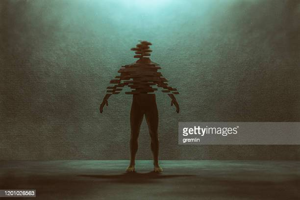 standing man falling apart - bisected stock pictures, royalty-free photos & images