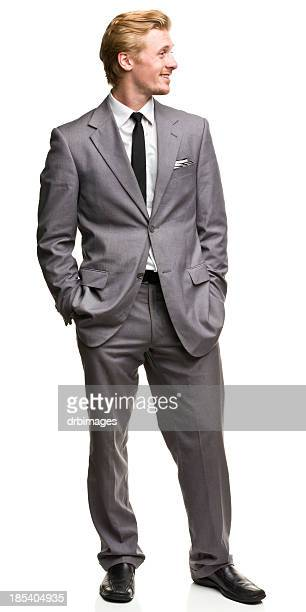 standing man in suit looks to the side - hands in pockets stock pictures, royalty-free photos & images