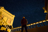 standing man looking at starry sky