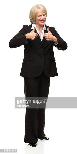 Standing Mature Woman Gives Thumbs Up