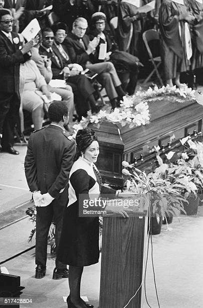 Standing near casket Mrs Martin Luther King delivers eulogy at funeral services of gospel singer Mahalia Jackson in McCormick Place Miss Jackson who...