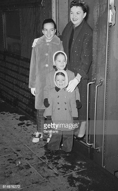 Standing near the door of the 20th Century Limited singer Judy Garland poses with her three children on arrival at Grand Central Station She was...