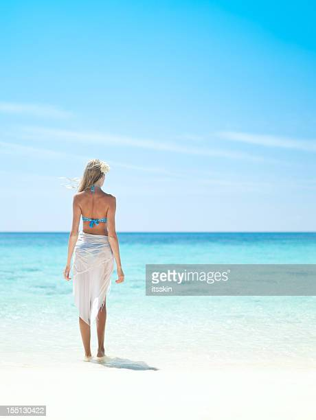 standing near the ocean - sarong stock photos and pictures