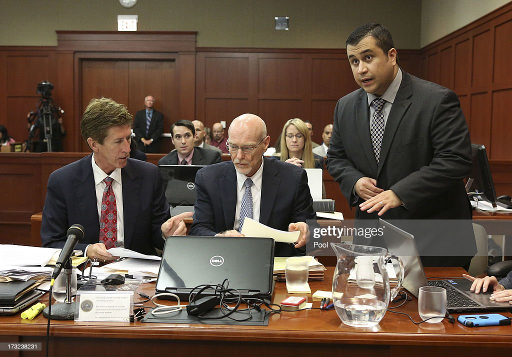 Standing next to his defense attorneys Mark O'Mara, (L), and Don West, (C), George Zimmerman addresses Judge Debra Nelson during his trial in Seminole circuit court July 10, 2013 in Sanford, Florida. Zimmerman has been charged with second-degree murder for the 2012 shooting death of Trayvon Martin.