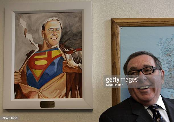 –Standing next to painting of himself depicted as Superman Joel P Moskowitz is the Chairman of the Board and CEO of Ceradyne Inc makers of body armor...