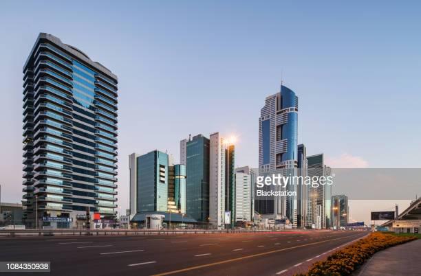 standing on a high place overlooking the city's tall buildings - alto descripción física fotografías e imágenes de stock